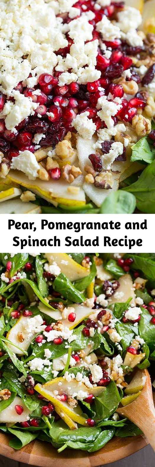 Pear, Pomegranate and Spinach Salad Recipe - This colorful salad is brimming with fresh flavor it's it's perfect for the holidays. I love how festive the arils look in this salad when paired with the greens, and of course I'm in love with the entire flavor combination of this salad!