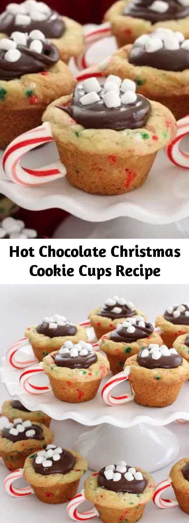 Hot Chocolate Christmas Cookie Cups Recipe - Hot Chocolate Cookie Cups are the most fun & festive Christmas cookies ever! Sugar cookie cups filled with fudge, mini marshmallows & sprinkles with a darling candy cane handle!